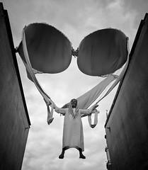 arab hanging on huge bra (Fanofuncleken) Tags: street art bra symmetry arab juxtaposition parachute poznan