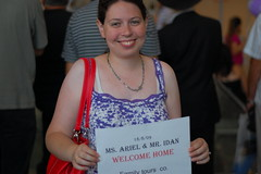 wifes with a sign (elibrody) Tags: family people ariel home airport welcome usatrip welcoming idan welcomehome