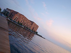 Thessaloniki Concert Hall (dranidis) Tags: blue light sunset sea sky music orange water clouds reflections geotagged golden hall concert waves afternoon waterfront angle perspective olympus greece thessaloniki 43 dimitris salonica concerthall thessalonika saloniki salonika fourthirds thessalonica  megaro  e520 zuiko1442mm  olympuse520 gimp26 dranidis dimitrisdranidis