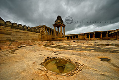 Lepakshi (ayashok photography) Tags: tower reflections temple nikon gopuram sigma1020mm andhrapradesh lepakshi rainyclouds nikonstunninggallery ayashok praveenslens 1stwideangleshot thankyoupraveen