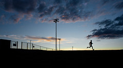 Escape! (Philerooski) Tags: sunset sky silhouette clouds fence escape running run runner sprint breakfree