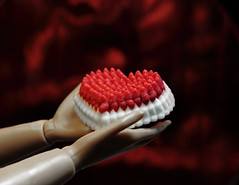 """Sweet heart (*Millie* """"Catching up slowly"""") Tags: icing happyvalentineday valentine sweet red barbie hands doll raynoxdcr250 macromondays sugar plastic heart cakedecoration flickrvalentine inspiredbylove tabletopphotography stilllife canonsx50"""