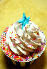 Blue Star Cupcake with Rainbow Sprinkles (Cillian Storm) Tags: pink blue food white green yellow cake dessert cupcake sweets delicacies