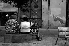 Life in Cordoba, Spain (Hannah_Stevenson) Tags: graffiti spain resting chatting miscellaneous gossiping grandmaandgranddaughter spanishladies childinpram