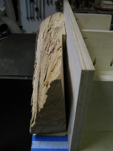 European olive log half on resawing jig