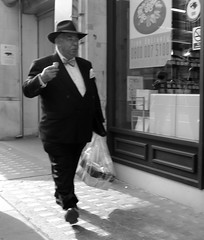 The Ice Cream Man (Ian Brumpton) Tags: street city uk england urban blackandwhite bw london blancoynegro shopping blackwhite britain candid citylife streetshots streetphotography streetportrait bowtie streetlife retro icecream chapeau gentleman blackdiamond gentlemen elegance panache streetphotographer englishness blackwhitephotos theunforgettablepictures neroamet