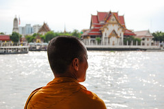 crossing Chao Phraya (marin.tomic) Tags: city travel urban orange water ferry river asian thailand temple boat nikon asia southeastasia bangkok religion sunny monk buddhism thai bkk chaophraya d40