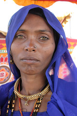 Nomadic woman at the camel fair in Pushkar, Rajasthan (sensaos) Tags: portrait people woman india festival asian person eyes sand asia desert retrato indian traditional culture traditions fair tribal jewellery clothes camel nomad persons tribe pushkar portret ritratto nomads cultural rajasthan портрет indigenous cultuur famke mensen papu azië nomadic camelfair 肖像画 bhopa 초상화 sensaos 画象
