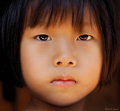 Who will blink first?...... (iamguava - ) Tags: girl thailand eyes pretty karen thai stare guava hilltribe maehongson padong longnecks kayan maehongsorn 5photosaday paduang   earthasia iamguava