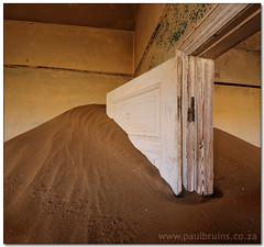 Dusty Doorway (Panorama Paul) Tags: diamonds ghosttown namibia soe kolmanskop nohdr shieldofexcellence nikfilters vertorama nikond300 wwwpaulbruinscoza paulbruinsphotography