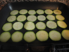 Courgette slices in grill pan
