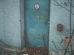 Lunch break (fincithreee) Tags: break no smoking panasonic g7 lost place door abandoned entrance factory old