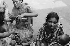 Life in the streets (N A Y E E M) Tags: break child mother bangladesh gec beggars chittagong fujifilmnatura1600 leicar9 nayeemkalam summiluxr50mme60