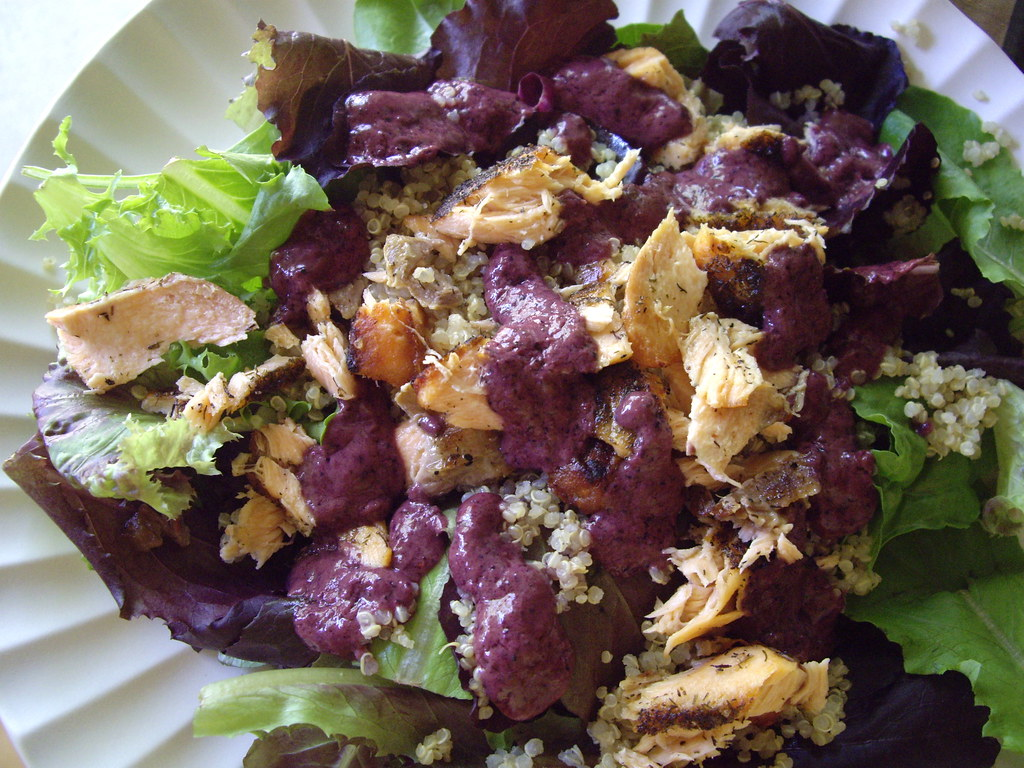 salmon and quinoa on baby greens with blueberry vinaigrette