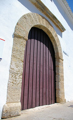 Bull Ring Door Ronda (cwgoodroe) Tags: summer costa white hot sol beach del bells spain ancient europe churches sunny bull bullfighter adobe ronda moors walls washed clothesline protective newbridge roda bullring stonebridge oldbridge spainish whitehilltown rondah spanishdoors