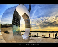 O :: HDR (:: Artie | Photography ::) Tags: sea sculpture reflection water clouds marina photoshop sunrise canon mirror singapore cs2 wideangle chrome wharf handheld mirrored 1020mm barrage hdr artie 3xp sigmalens photomatix tonemapping tonemap manart 400d marinabarrage rebelxti