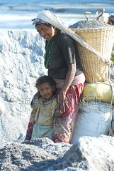 Mother and child (Nepalese photojournalist) Tags: bridge nepal sleeping sunset woman snow man color water students smile swimming writing radio plane asian army milk dance fight fishing sand women king child eating smoking weapon kathmandu aim pick motherandchild vitamin maoist booting