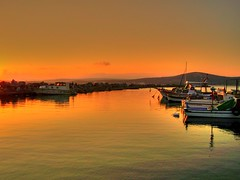 Golden light (Metin Canbalaban) Tags: voyage trip sea vacation holiday reflection sunrise turkey boat trkiye explore frontpage deniz sandal izmir ege tatil kayk eme turkie gndoumu kzl lca abigfave ilca anawesomeshot infinestyle theunforgettablepictures platinumheartaward metincanbalaban saariysqualitypictures magicunicornverybest