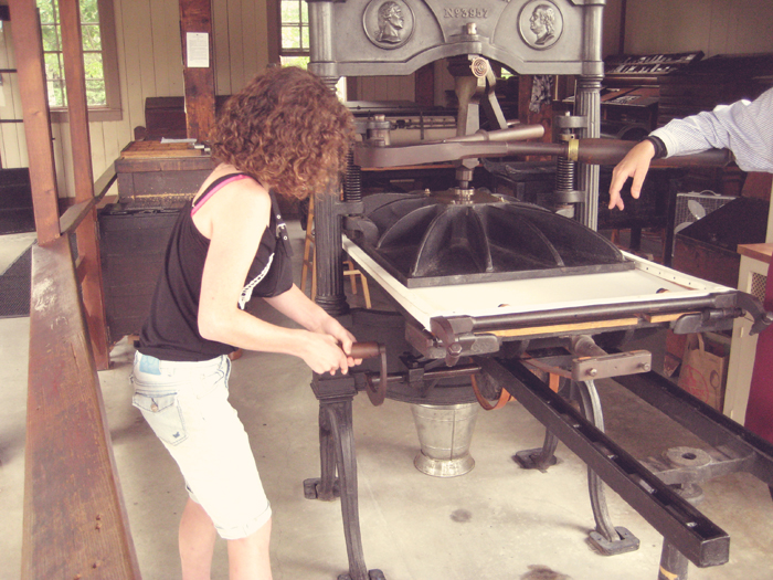 working the old-fashioned printing press