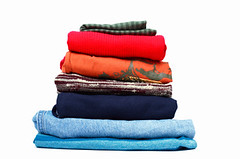 Stack of Clothing (ahannon1) Tags: blue red orange colors fashion shirt store sweater clothing pants group objects stack clothes clean jeans whitebackground textile shirts cotton laundry pile backgrounds denim casual material tall folded copyspace heap arrangement isolated multi garment