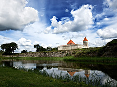 (112) The Episcopal Castle (Kuressaare, Saaremaa island, Estonia) (Berlinalex) Tags: street travel blue summer sky orange cloud color reflection building green tower castle tourism nature beautiful grass architecture landscape geotagged ancient flora heaven estonia traditional landmark olympus baltic medieval oldtown reflexion ostsee episcopal burg eesti kuressaare estland mittelalter estonie baltique e510 saaremaa baltikum