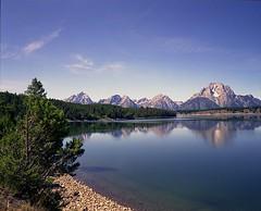Jackson Lake and Tetons #3 (wanderingYew2) Tags: lake reflection film mediumformat geotagged nationalpark rockymountains wyoming jacksonhole filmscan grandtetonnationalpark jacksonlake mamiya7ii geo:lat=43846111 geo:lon=11059782