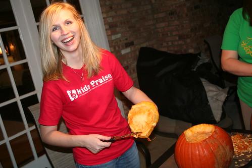 Jamie carving her pumpkin hat