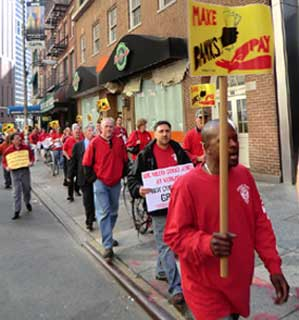 Angry about budget cuts and growing income inequality, New York City CWA members and leaders joined 20,000 activists from a broad coalition of organizations for a May 12 march on Wall Street.