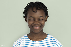 Cheerful Girl Standing Smiling  Concept (byrawpixel) Tags: notfullbody peoplecollective peoplestudio photo photoa photographerjira portrait premiumimage studio studio30 african background casual cheerful child childhood closedeyes cute descent emotion expression face female fun funny girl happiness happy hilarious isolated isolatedonwhite kid laughing little people person pretty smiling stripes white woman young youth