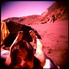 beach yoga face (pixietart) Tags: sanfrancisco california black feet beach face holga funny cross squint sands process alita