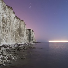 The wonders of modern transport (Alex Bamford) Tags: longexposure sea moon night dark sussex chalk cliffs fullmoon moonlit moonlight southcoast moonlighting explored interestingness243 i500 lostamerica alexbamford thebigbambooly brightonflickr2009bookpick wwwalexbamfordcom troypavia