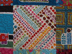 close up (joontoons) Tags: ikea quilt handmade sewing fabric quilting redandblue patchwork birthdaygift applique gardenparty alexanderhenry freemotionquilting ikeafabric annamariahorner sandihenderson joontoons