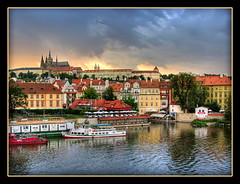 Prague Sunset (Mike G. K.) Tags: city bridge sunset sky panorama reflection castle water architecture clouds buildings reflections river geotagged boat ship view prague cathedral border praha medieval explore frame czechrepublic charlesbridge vltava hdr slope karlovmost praguecastle prazskyhrad saintvitus photomatix interestigness explored 3exp geo:lat=50086515 geo:lon=14411117 mikegk:gettyimages=submitted