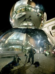 self portrait with big balls (mugley) Tags: camera city portrait urban selfportrait colour reflection 120 film jes me night ball mediumformat mall shopping hair bag lights mirror 645 fuji photographer legs distorted pavement tripod australia scratches negative motionblur policecar shops paving adelaide epson cbd sa stores beanie 6x45 southaustralia mamiya645 bloke manfrotto rundlemall ballhead lowepro cablerelease c41 reala100 v700 mamiya645protl m645 486rc2 slingshot200aw mugley fujicolorsuperiareala100 35mmf35sekorn 055db