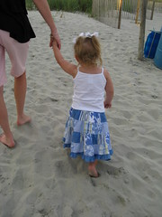 Clara Ann walks in the sand