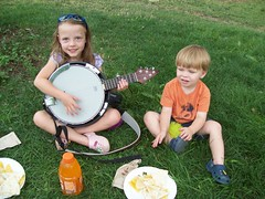 Trying out J.R.'s sawed-off banjo at RockyGrass 2009