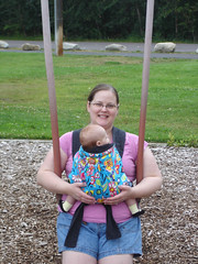 with Mommy, first time on the swing