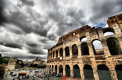 Roman Holiday (` Toshio ') Tags: sky people italy rome roma building history tourism architecture clouds italian ancient europe italia european roman forum wideangle tourists structure colosseum mortar historical coliseum colloseum crowds hdr europeanunion colosseo gladiators toshio flavianamphitheatre coloseo anfiteatroflavio amphitheatrumflavium highdynamicresolution
