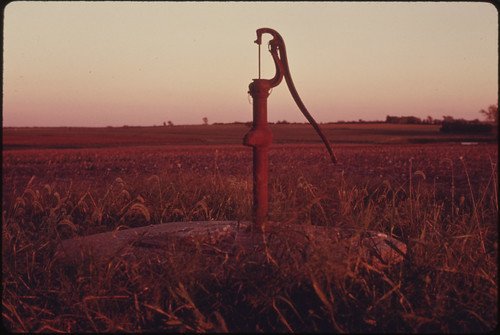 Rusted Iron Hand Pump on Land Which Used to Be Covered by Tallgrass Prairie in Johnson County Kansas near Kansas City...09/1974