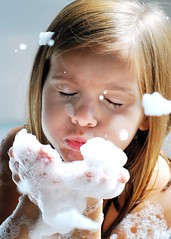 Blow (krispycrunch6) Tags: girl 50mm nikon october bath child illumination bubbles picnik suds oneword shuttersisters
