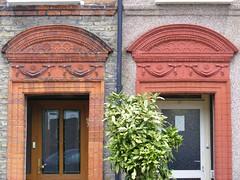 Ilford Victorian Porticos (sludgegulper) Tags: decorative doorway kings seven ilford redbridge