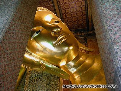 Golden face of the sleeping Buddha