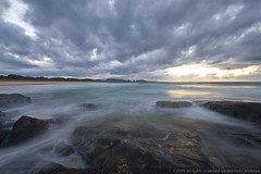 Kioloa dawn I (NavindaK) Tags: ocean longexposure sea seascape beach water clouds sunrise campus landscape geotagged dawn coast sand rocks waves australia nsw headlands newsouthwales southcoast anu availabledarkness top20longexposure kioloa anucoastalcampus geo:lat=35545706 geo:lon=150385419