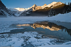 Winter Morning on Lake Louise (Marc Shandro) Tags: winter snow mountains cold reflection ice nature rockies bluesky alberta wilderness lakelouise lowsun getty2 skyandatmosphere