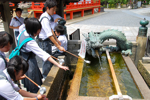 schoolkids washing before entering kiyomizudera, kyoto