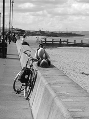 bike girl beach and a good stretch (byronv2) Tags: street blackandwhite bw woman beach girl bike bicycle coast scotland blackwhite edinburgh cyclist exercise legs candid stretch forth coastal promenade portobello riverforth monchrome rnbforth