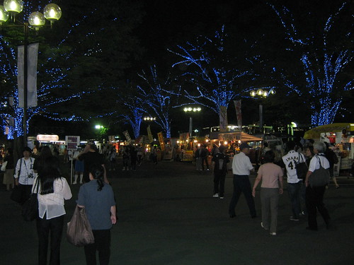The area just outside the stadium at night.