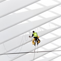 Spiderman at work (in Lige Guillemins) (Gilderic Photography) Tags: belgium belgique belgie liege luik luttich guillemins gare station spiderman hommearaigne fil filin architecture cable diagonal line structure santiago calatrava man working worker ouvrier alpiniste vertige eponge sponge cleaning white blanc propre yellow orange homme danger raw lightroom humor humour future comics canon eos 500d minimal grey shadow aplusphoto superaplus geometry geometrie grid grille ligne action europe