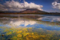 Batur lake and volcano (tropicaLiving - Jessy Eykendorp) Tags: longexposure light sky bali lake nature water clouds reflections indonesia landscape volcano rocks crater batur kintamani efs1022mm lakescape outdoorphotography the4elements canoneos50d tropicaliving hoyandx400 hitechfilters rawproccessedwithdigitalphotopro tiffproccessedwithadobephotoshopcs3 baturlakeandvolcano