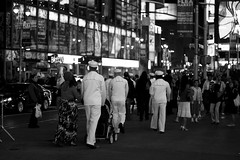 Sailors in Times Square (DJOtaku) Tags: nyc newyorkcity blackandwhite bw usa white ny newyork black random manhattan military navy places timessquare northamerica sailor armedforces 42ndstreet continents canonef50mmf18ii typeofshot lensesandflashes